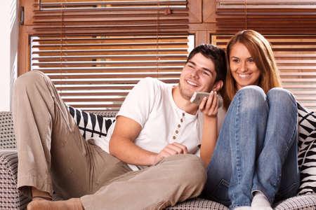 couple watching tv: young couple watching tv Stock Photo