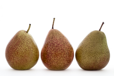 speckled: Three speckled pears on a white background. Stock Photo