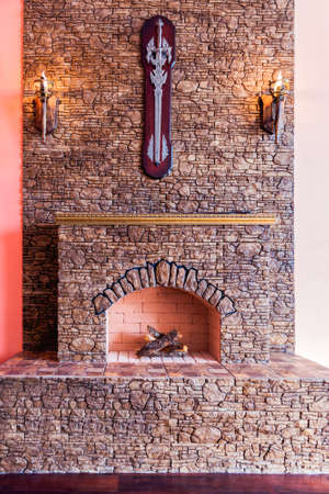 stone fireplace: Stone fireplace with the lamps and bricks