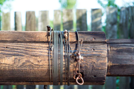 wishing: Wooden Well crank with the hawser rope.