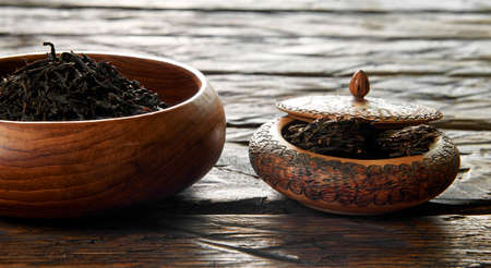 dryed: Dried tea in wooden dish on the table Stock Photo