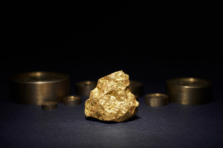 constancy: Closeup of big gold nugget and weights copper
