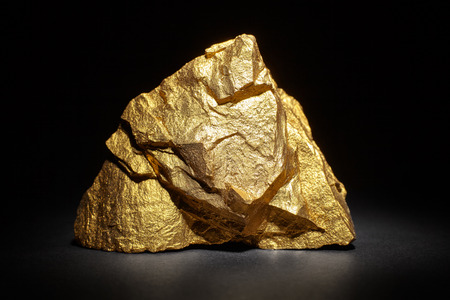 constancy: Closeup of big gold nugget on a black background
