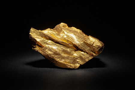 Closeup of big gold nugget on a black background Reklamní fotografie - 62561162