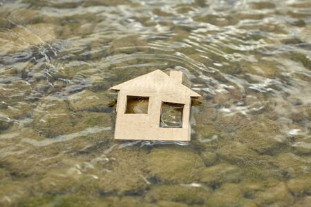 Cardboard house by the sea. Homeless child. Refugee problem. Concept of finding a better life.