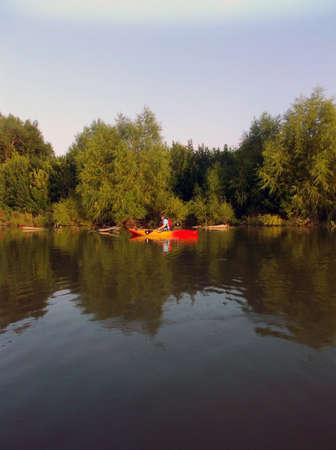granger: Kayaker calmly floating in the water of Granger Lake, Texas