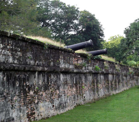 defended: Two Canons perched on the wall od Fort Cornwallis