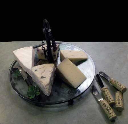 Platter of different cheese varieties isolated on black