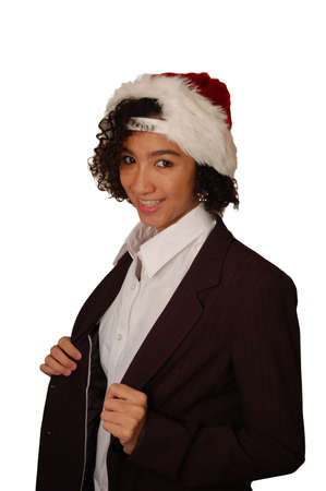 grade school age: Curly haired teenage girl in dress jacket and Santa hat