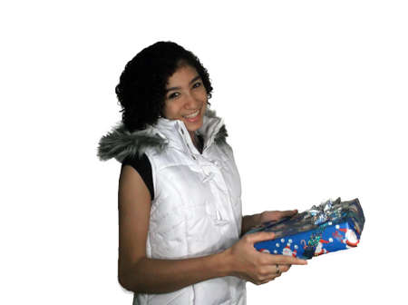 grade school age: Pretty mixed race girl in white vest holding a gift
