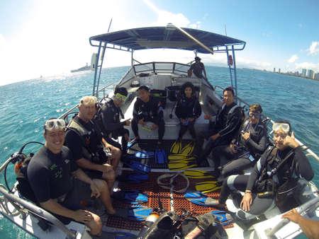 Group of Scuba Divers on a boat Sajtókép