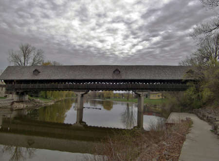 covered bridge: Stormy covered bridge with storm clouds Stock Photo