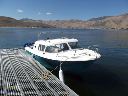 cruiser: 1950s Dorsett Cabin Cruiser Boat docked in a lake