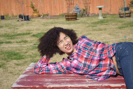 silly: Teen girl in plaid shirt making silly face Stock Photo