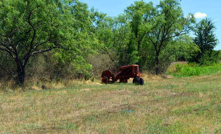 Old Rusty tractor in a field