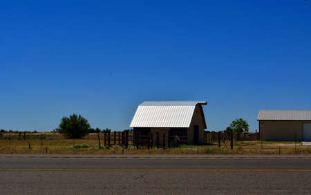 Metal Barn in a field on the side of the road