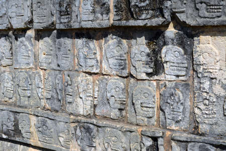 Mayan Skull carvings on a wall at Chichen Itza