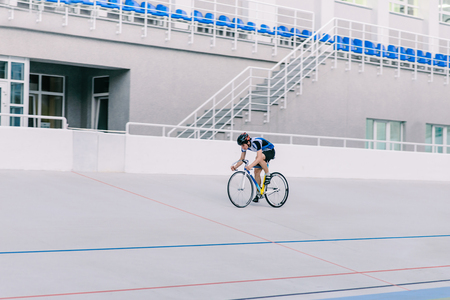 A cyclist trains on a cycling track. Professional sportsman on a bright bike Stock Photo