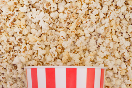 Background. Popcorn and bowl top view, cinema concept. Flat lay. Copyspace Stock Photo