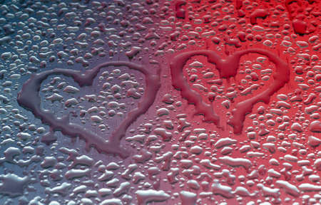 metal surface: Water drops form hearts on a metal surface Stock Photo