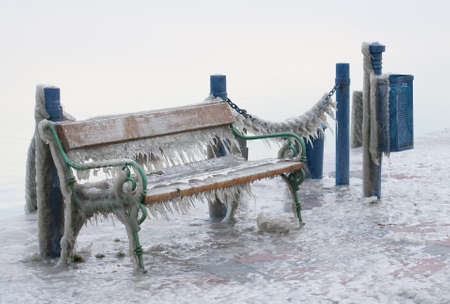 landing stage: Icicles on a bench of a landing stage