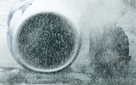 Aircraft engine in a snowstorm Фото со стока