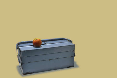 blue toolbox with an apple on top photo