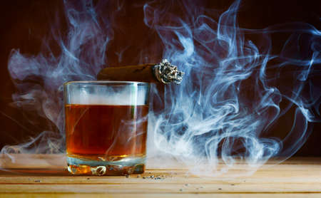 manlike:  Alcohol and cigar