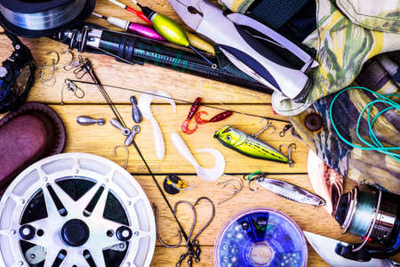 fly fishing: Fishing gear on the table as a frame Stock Photo