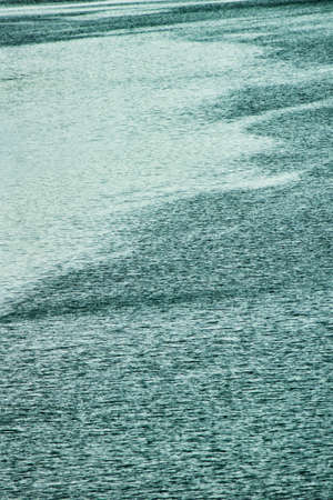 The surface of the water rippling