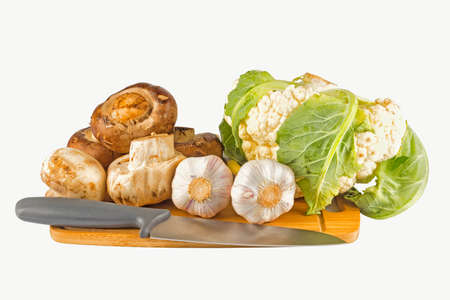 button: Mushrooms and vegetables on an isolated background Stock Photo