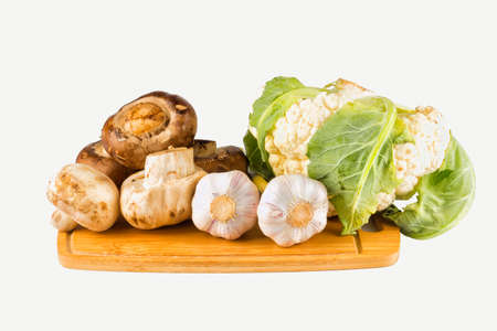 button: Mushrooms and vegetables on white isolated background