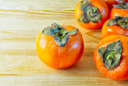 Ripe juicy and sweet persimmon fruit Stock Photo