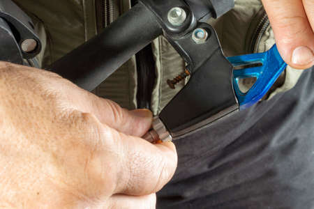 Adjustment and repair of the brake handle on the bike Stock Photo