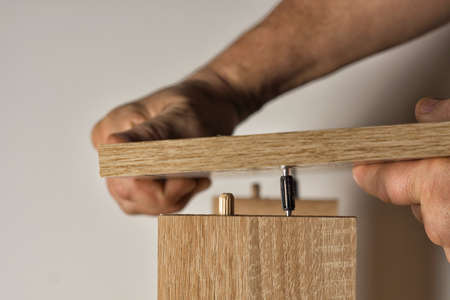 Installation using a threaded furniture fastener tool Stock Photo