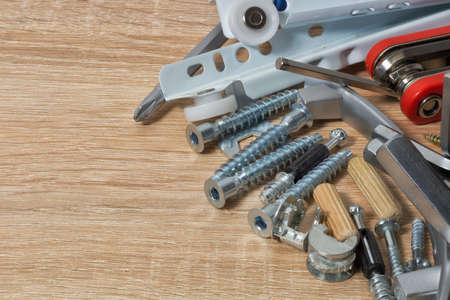 Fasteners and tools for furniture assembly Stock Photo