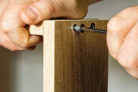 The fastener installed in the corresponding slot Stock Photo