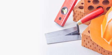Construction hand tools and bricks Stock Photo