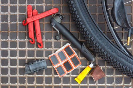 Accessories for repairing punctured bicycle chambers