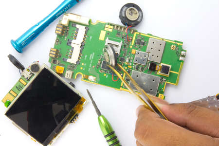 Mobile phone repair by electronic technician