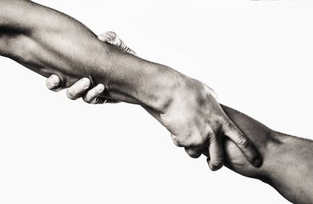 Close up help hand. Two hands, helping arm of a friend, teamwork. Rescue, helping gesture or hands. Black and white. 版權商用圖片