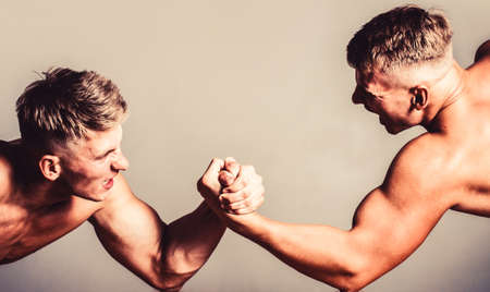Hand wrestling, compete. Hands or arms of man. Muscular hand. Two men arm wrestling. Rivalry, closeup of male arm wrestling. Men measuring forces, arms