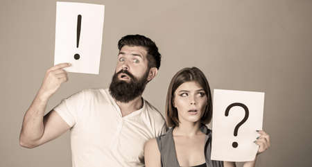 Woman and a man a question, exclamation point. Couple in quarrel. Question mark. Quarrel between two people. Pensive man and a thoughtful woman. Husband and wife not talking, being in quarrel