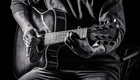 Music concept. Guitar acoustic. Play the guitar. Live music. Music festival. Instrument on stage, band. Electric guitar, guitarist, musician rock. Musical instrument. Guitars, strings. Black and whit