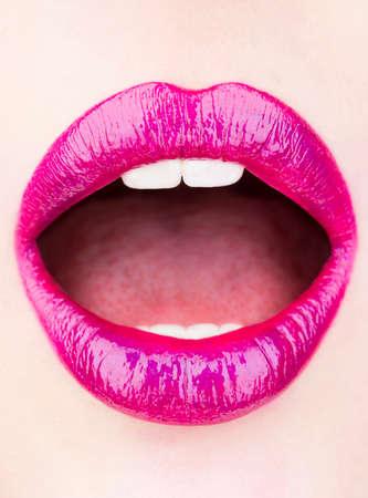 Isolated red lips portrait. Red lips, makeup, sensual mouth, sexy lip. Lipstick or lipgloss. Beauty lips, beautiful lip, bright pink lipstick