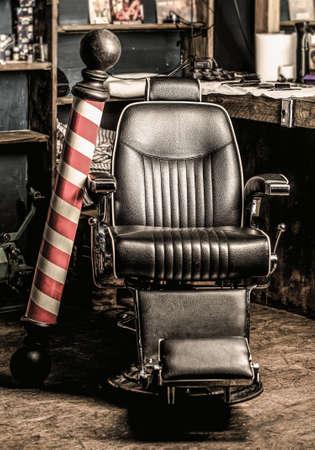 Barber shop pole. Hairstylist in barbershop interior. Barber shop chair. Barbershop armchair, salon, barbershop for men Stockfoto