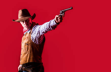 West, guns. Portrait of a cowboy. owboy with weapon on red background. American bandit in mask, western man with hat