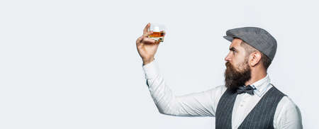 Sipping finest whiskey. Portrait of man with thick beard. Macho drinking. Bearded gentleman drink cognac. Stylish rich man holding a glass of old whisky. Copy space