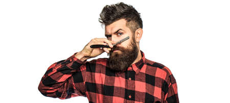 Bearded man, long beard, brutal, caucasian hipster with moustache. Vintage straight razor. Mens haircut in barber shop. Barber straight razor, barber shop Standard-Bild