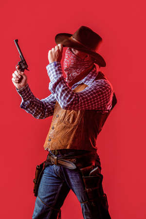American bandit in mask, western man with hat. Man wearing cowboy hat, gun. West, guns. American cowboy. Cowboy wearing hat. Western life. Guy in cowboy hat